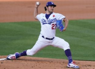 Bauer earns 6th win
