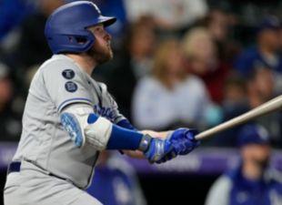 Muncy powers Dodgers past Rockies in extras