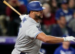 Pujols, Dodgers top Rockies in extras